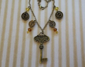 """Brass Metal Pendant Necklace of Found Objects: Vintage Style Key, Buttons, Citrine & Amber Beads on 30"""" Brass Link Chain with Lobster Clasp"""