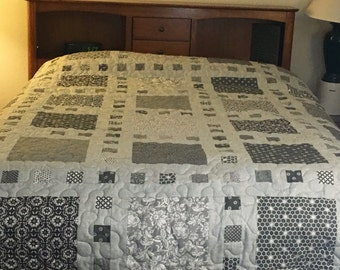 This is a new handmade queen size quilt featuring assorted gray fabrics.