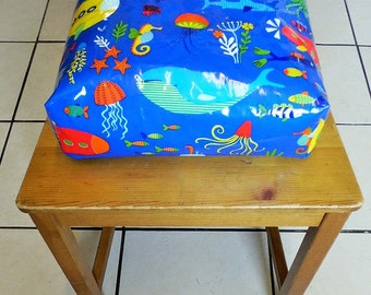Toddler booster  cushion, zipped, refillable,with ties. Wipeable laminated under the sea fabric.