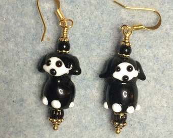 Black and white lampwork puppy dog bead earrings adorned with black Czech glass beads.