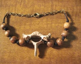 The Secret - Raccoon bone and wooden bracelet