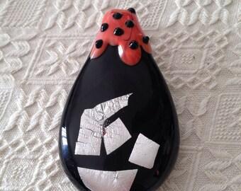 Drop: drop-shaped Murano glass pendant.  Black-silver color-orange.