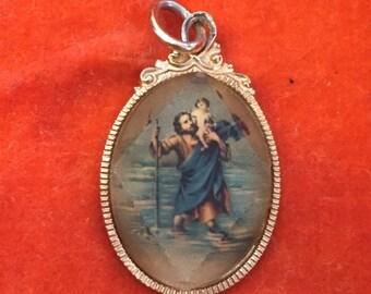 Jesus pendant on gold metal