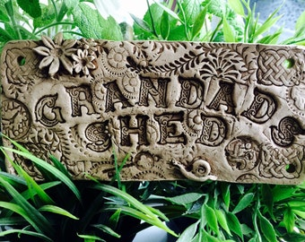 """Ceramic Garden Sign with embossed text """" Grandad's shed"""""""