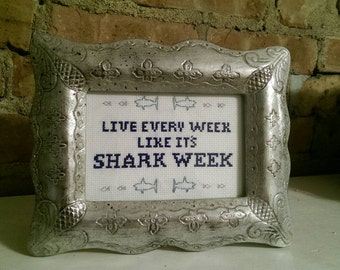 """30 Rock Tracy Jordan funny quote finished cross stitch, """"Live every week like it's shark week"""""""
