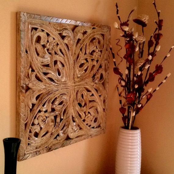 Rustic antique wall panel of reclaimed wood hand carved