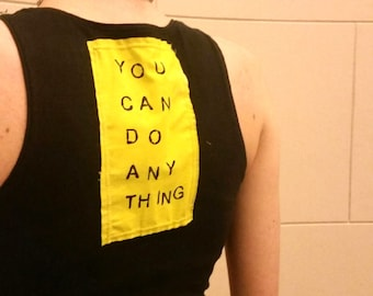 Upcycled hand printed positive message on spandex shirt.