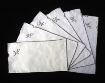 "Six Cream Cotton Napkins with an embroidered floral motif in one corner. 11""x 10.5"" (28x 26.5 cm) (Ref 3723 )"