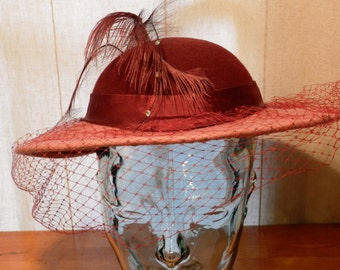 Vintage Women's Hat Designed by Sylvia 100% Wool Doeskin Felt Maroon over Pink with Netting and Feather dotted with Crystals 21 Inch  00815