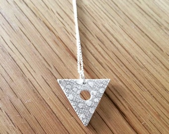 Fine silver triangle with circular hole