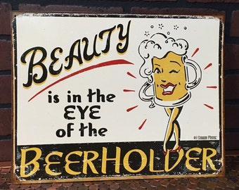 Beauty in the Eye of the Beer Holder tin sign