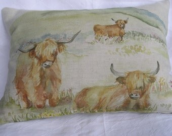 Highland cattle in landscape linen cushion cover.