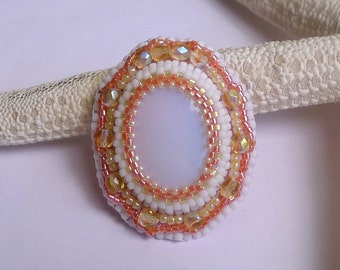 Brooch cabochon Opal stone embroidered with beads, white and orange