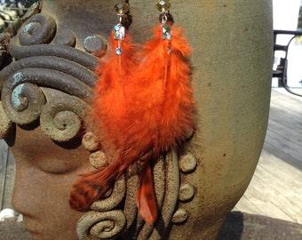 Beautiful orange feather earrings