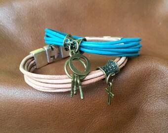 Handmade leather charm bracelet.