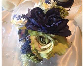 Blue bridal bouquet, blue peonie, green large rose, thitles. Wedding bouquet.