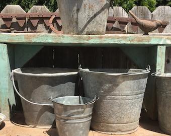 Rusty metal buckets