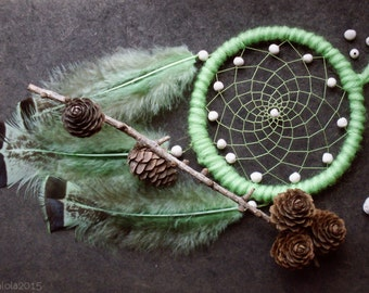 Green dreamcatcher with fluffy feathers and ceramic beads