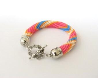 Bead bracelet in pink. A zigzag pattern. The geometrical pattern.Bead rope bracelet Beaded Embroidery