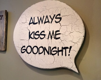 "Speech Bubble with ""always kiss me goodnight!"" quote."