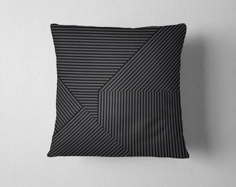 Black and grey geometric striped pillow