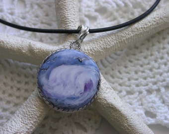 One of a kind cabuchon with a beach theme. Handpainted breaking wave, painted on a silver cabuchon and then encased in resin.