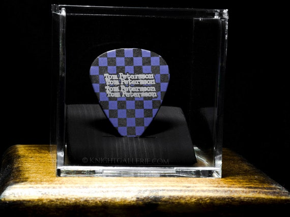 tom petersson cheap trick guitar pick in a display case. Black Bedroom Furniture Sets. Home Design Ideas