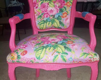 beautiful accent chair fuchsia frame with floral pink fabric,the back side and arms is upholstered with blue vinyl