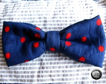 Handmade blue bow tie with red spots