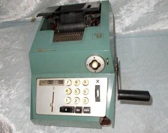 Vintage Olivetti summa prima cast iron calculator.