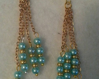 Gold toned chain and blue pearl dangle earrings
