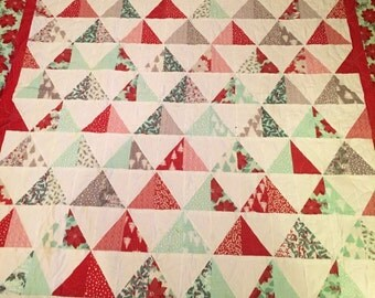 Christmas quilt, homemade, hand pieced, Christmas tree triangles, poinsettia, quilted in poinsettia p