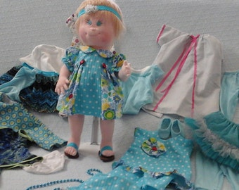 Soft Sculpture Doll and Assorted Clothing