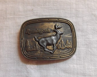 Vintage Remington Belt Buckle featuring a White Tailed Deer sculpted by Sid Bell