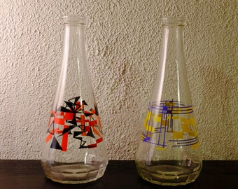 Two glass pitchers or vases