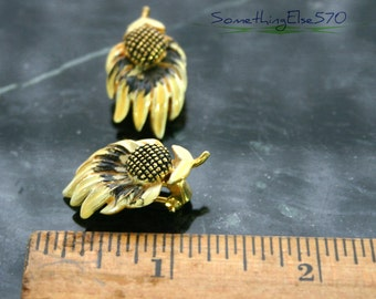 Vintage, BSK earrings, clip on, beautiful flower, yellow, gold colored, intricate detail flower detail. Gold colored back.