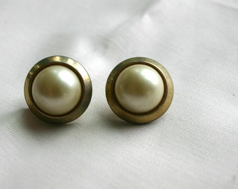 Vintage pierced earrings.  Pearl like center with gold trim.