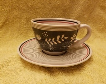 Swiss pottery Cup and saucer made in Switzerland Tea cup