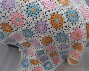 Crochet baby blanket in pastel colors