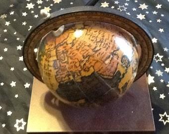 A vintage Italian globe pen holder for the desk