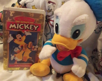 Vintage Baby Donald and VHS Tape