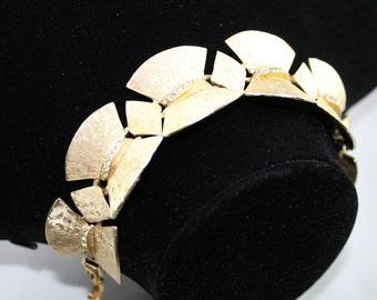 Vintage signed ART Goldlink and Rhinestone bracelet