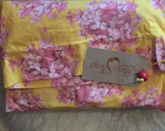 Yellow and pink floral baby wearing sling