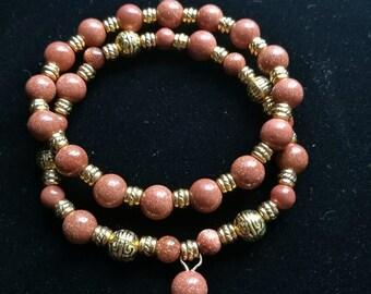 Gold stone beaded 2 bracelets , gemstone beads