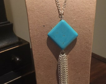 Turquoise Large Bead with Tassel.