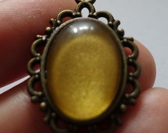Gold, oval, handmade pendant, one of a kind.