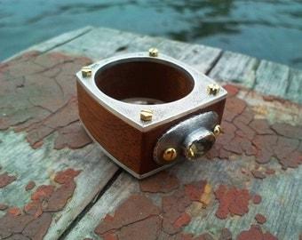 Silver and wood ring. Mahogany. Bronze bolts. Citrine.
