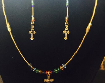 Delicate colorful crystal snd glass beaded cross necklace and earring set.