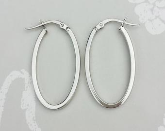 Ladies Fine 9ct White Gold Oval Hoop Earrings