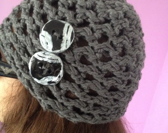 Hat decorated with handmade buttons, knitting, laced